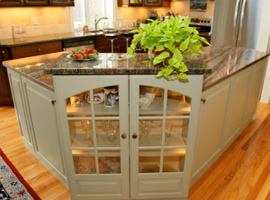 kitchen island with glass cabinet doors