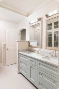 Master bath with 2 sinks and 2 mirrors