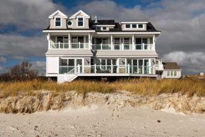 Back of custom home set on the beach