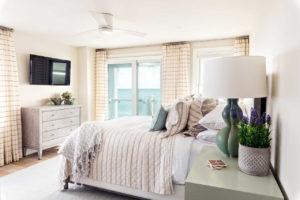 Bedroom with slider doors and an ocean view