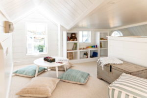 Upstairs room with builtins and throw pillows