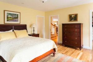 Master bedroom with wood floor