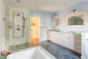 bathroom with tub and walkin shower