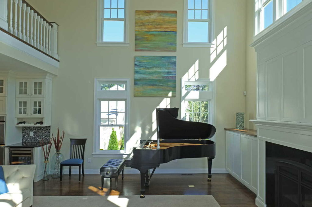 Sitting room with piano and very high ceiling