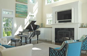 Sitting room with fireplace and a built in TV