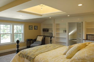 Master bedroom with a chandelier