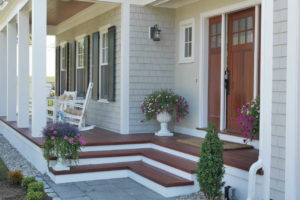 Front porch with stairs and rocking chairs
