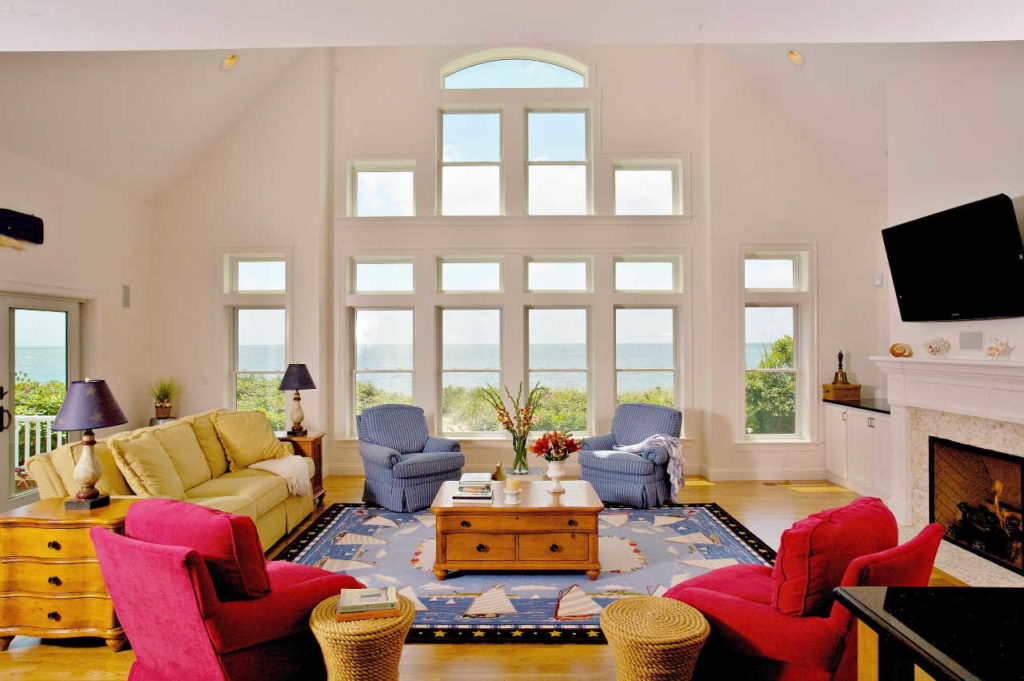 Large living room with windows in the shape of a pyramid