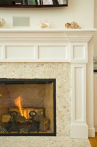 Stone fireplace with fire lit