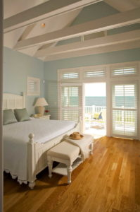 Bedroom with doors leading out to the deck