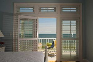 Door leading out to deck with ocean views